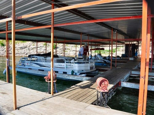 Boats covered by dock