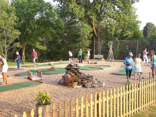 People enjoying mini golf
