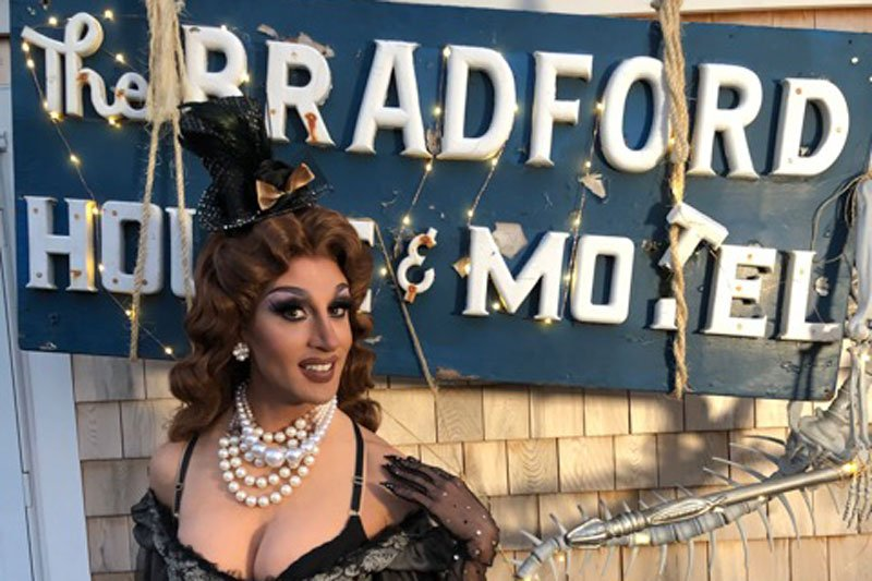 Woman in front of The Bradford Inn's Sign