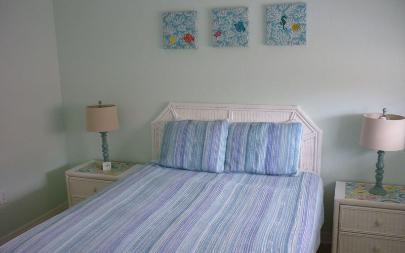 One queen size bed with two nightstands
