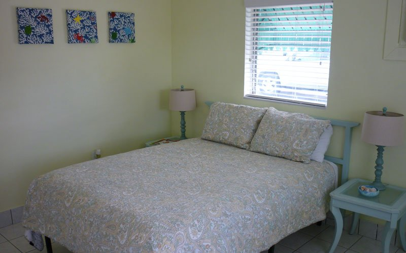 Queen size bed with two nightstands and window
