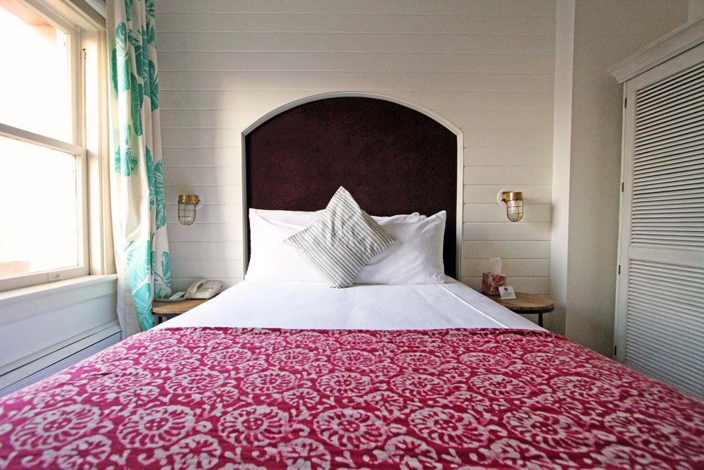 Bed with red Seashell spread