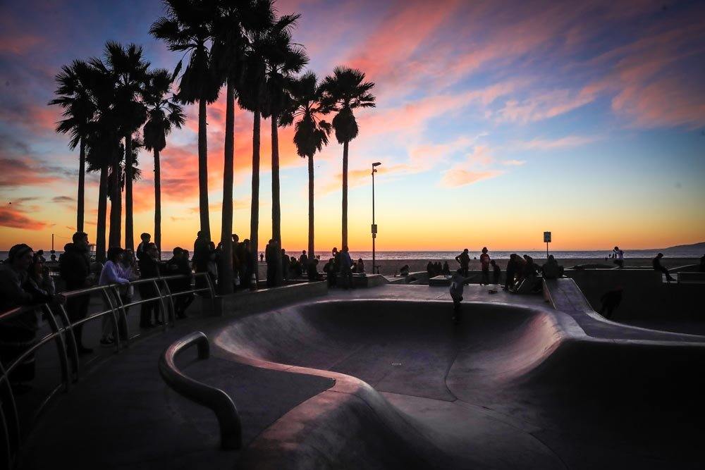 crowded skate park at sunset