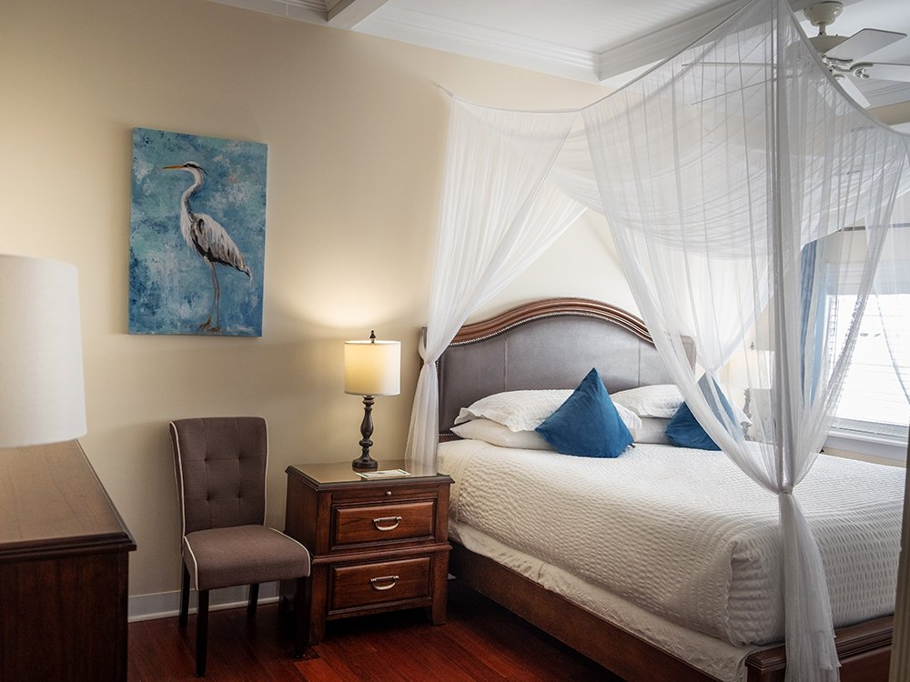 king bed with blue pillow