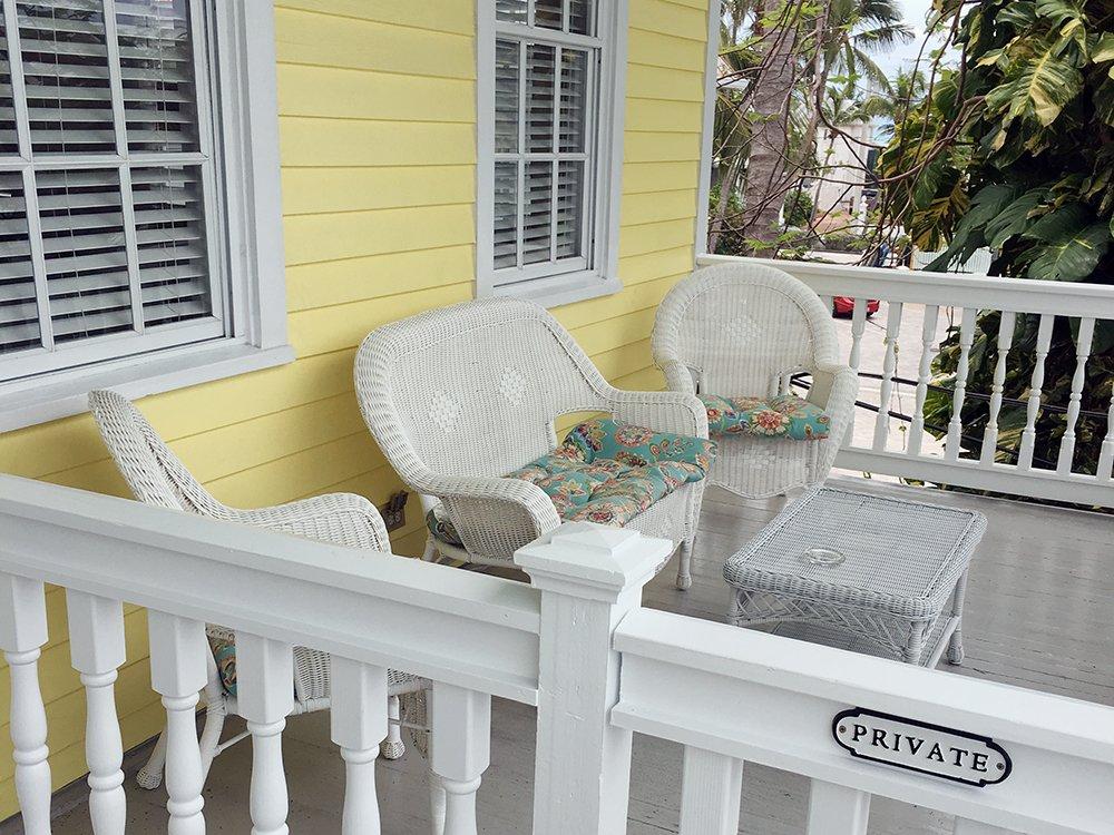 private porch with wicker furniture