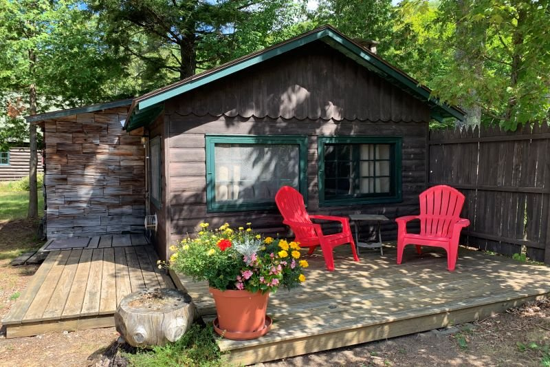 cabin with two porches and three chairs