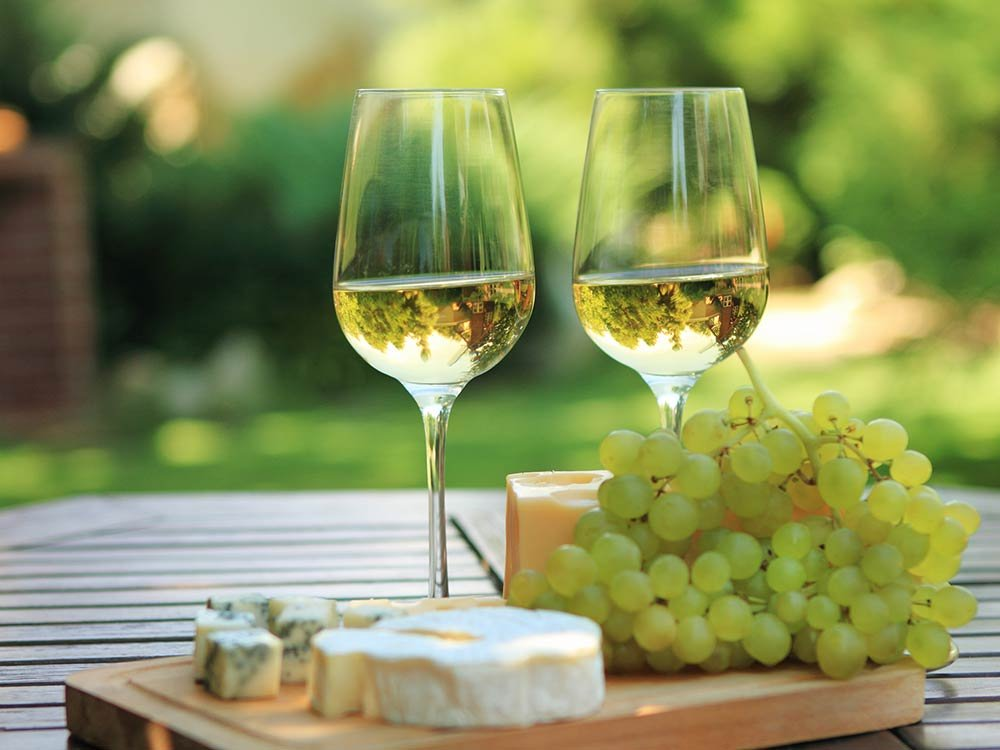 Wine Glasses, Cheese and Grapes