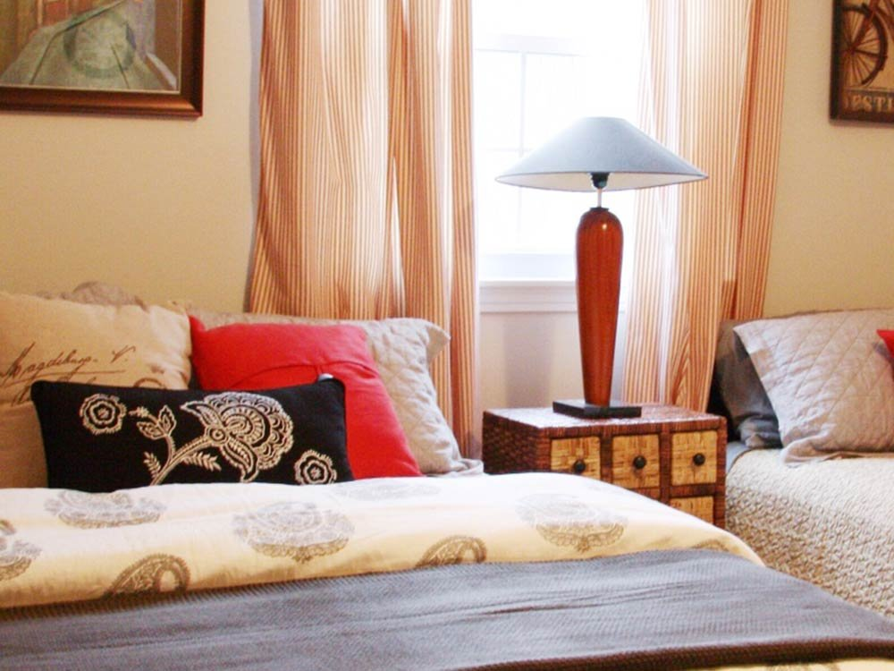 Two Beds with Decorative Pillows