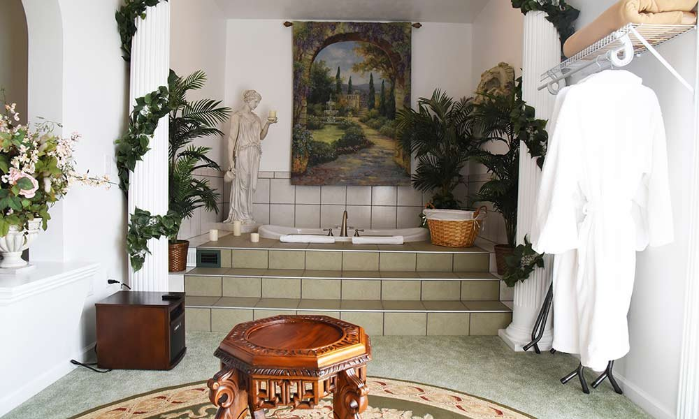 bathtub with roman decor