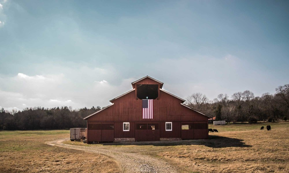 A large barn with an American flag
