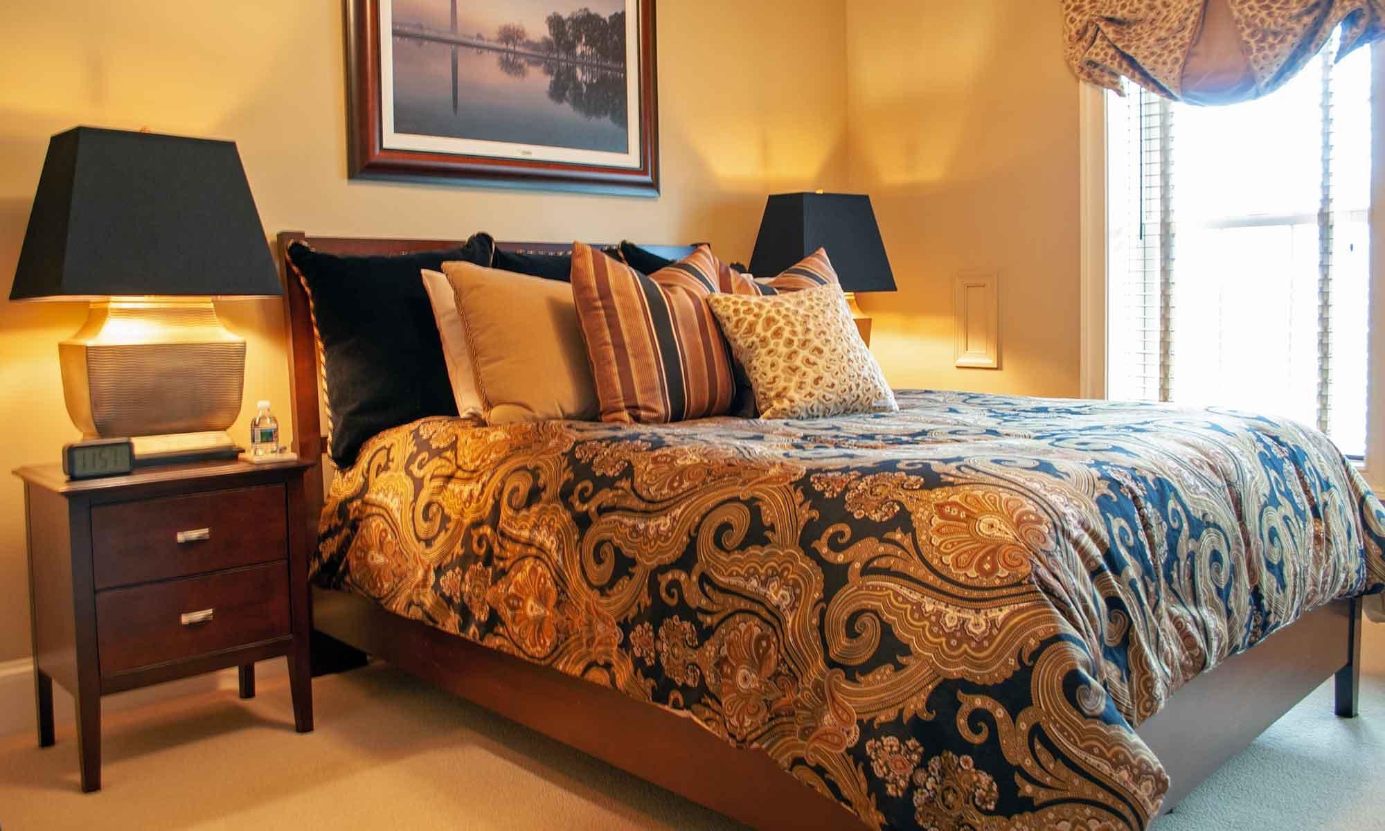 King bed next to window and bedside lamps