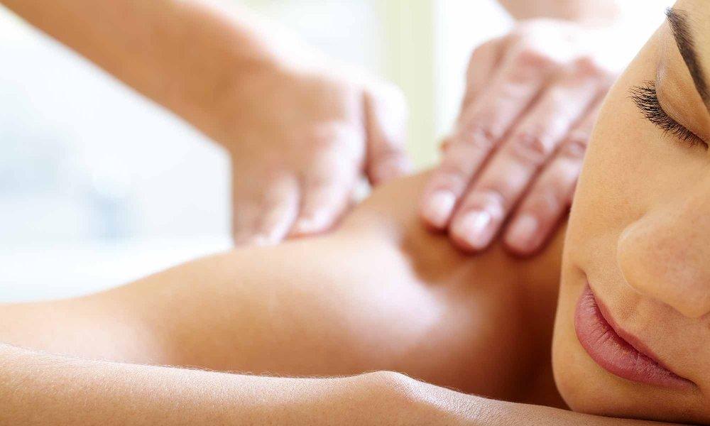 hands giving shoulder massage