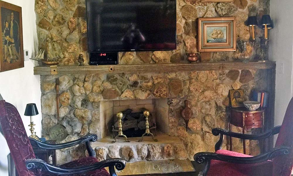 Chairs in Front of Stone Fireplace