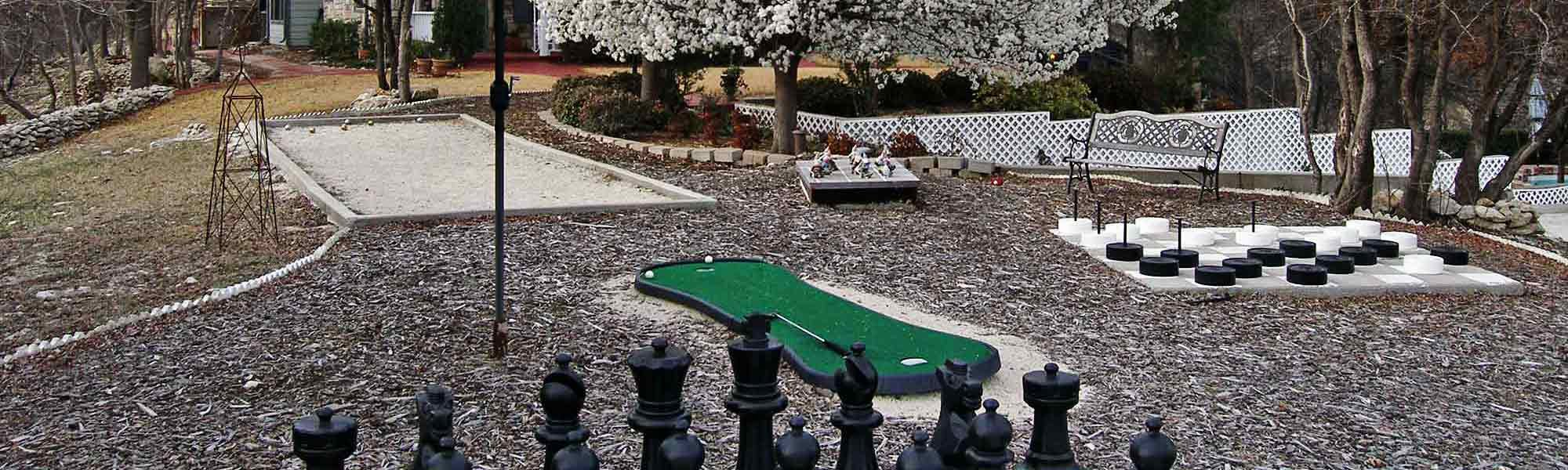 backyard games of checkers, mini golf, and chess