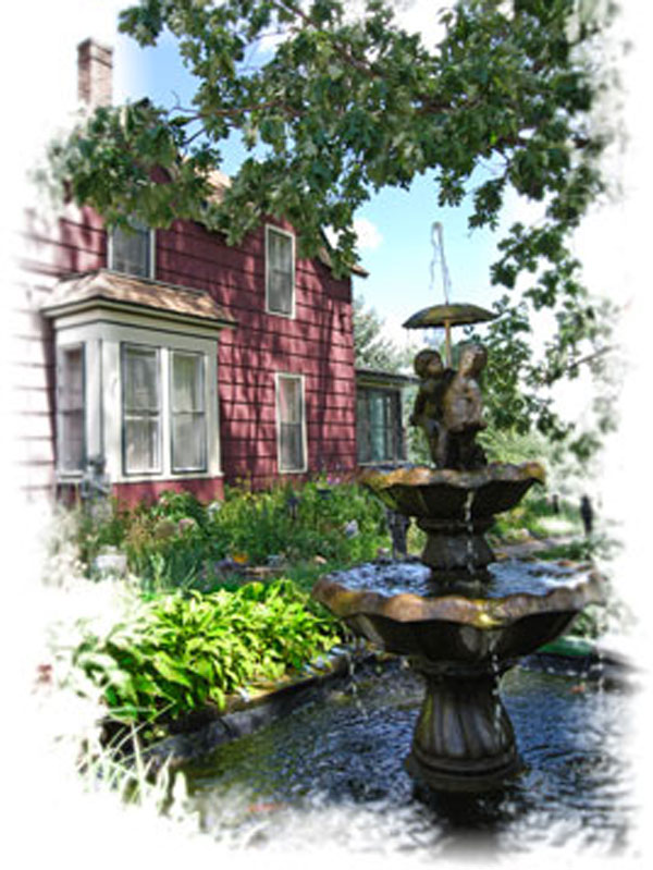 Courtyard with fountain infront of large brick house