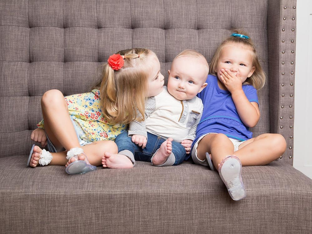 three children in a chair