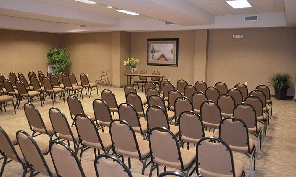 Rows of chairs in set up in meeting room