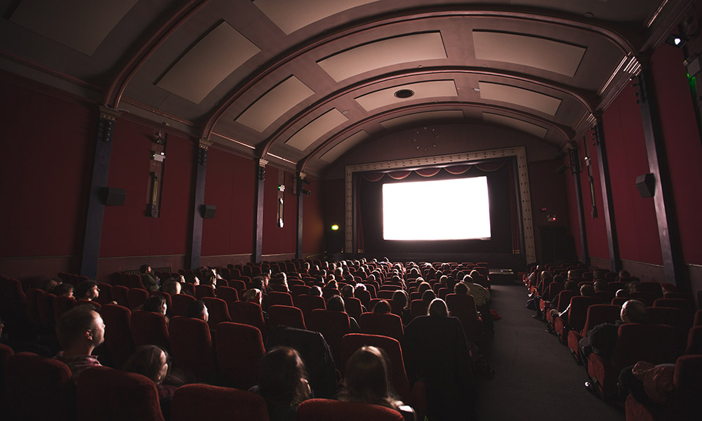 People watching movie screen in theater