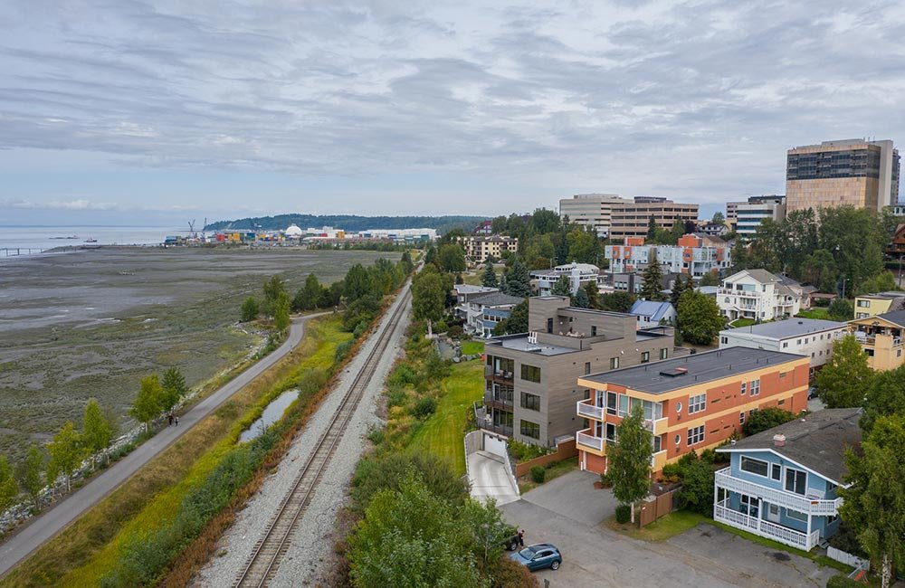 Apartment Buildings next to train track and ocean