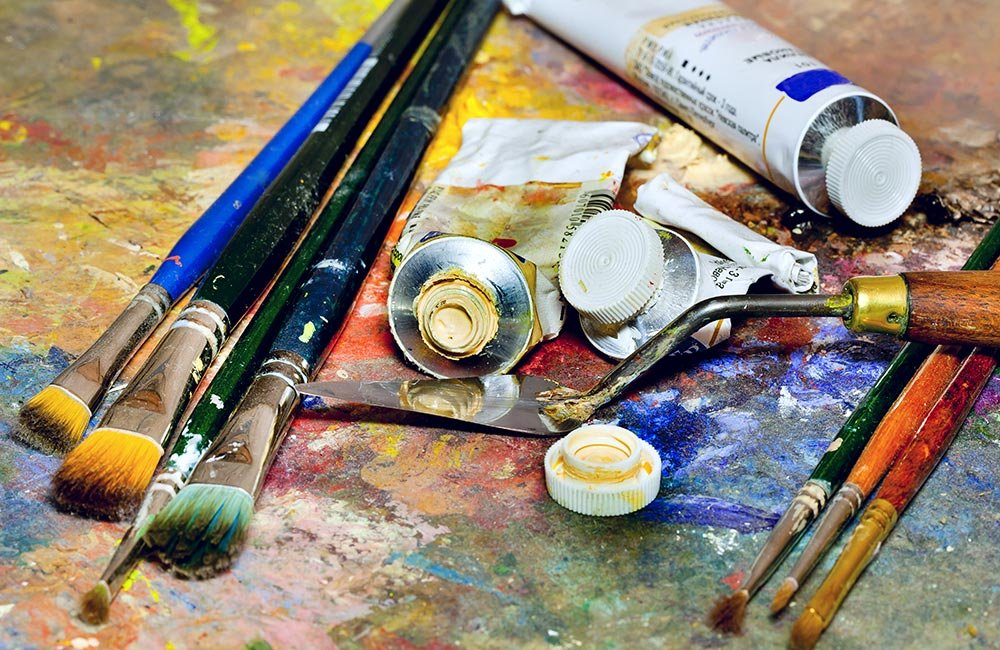 Paint and brushes on a canvas