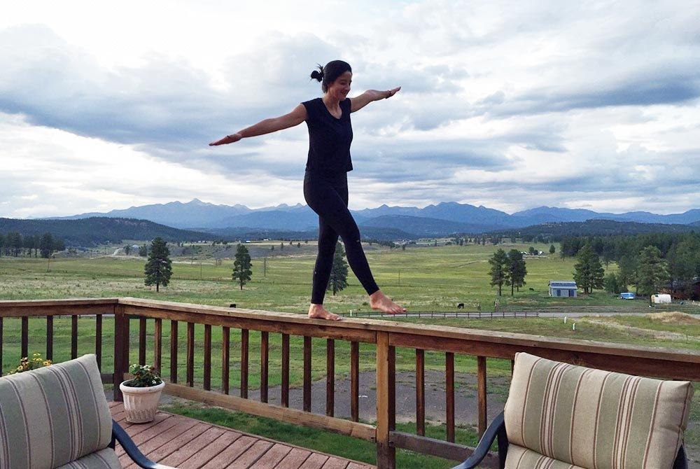 woman balancing on a railing