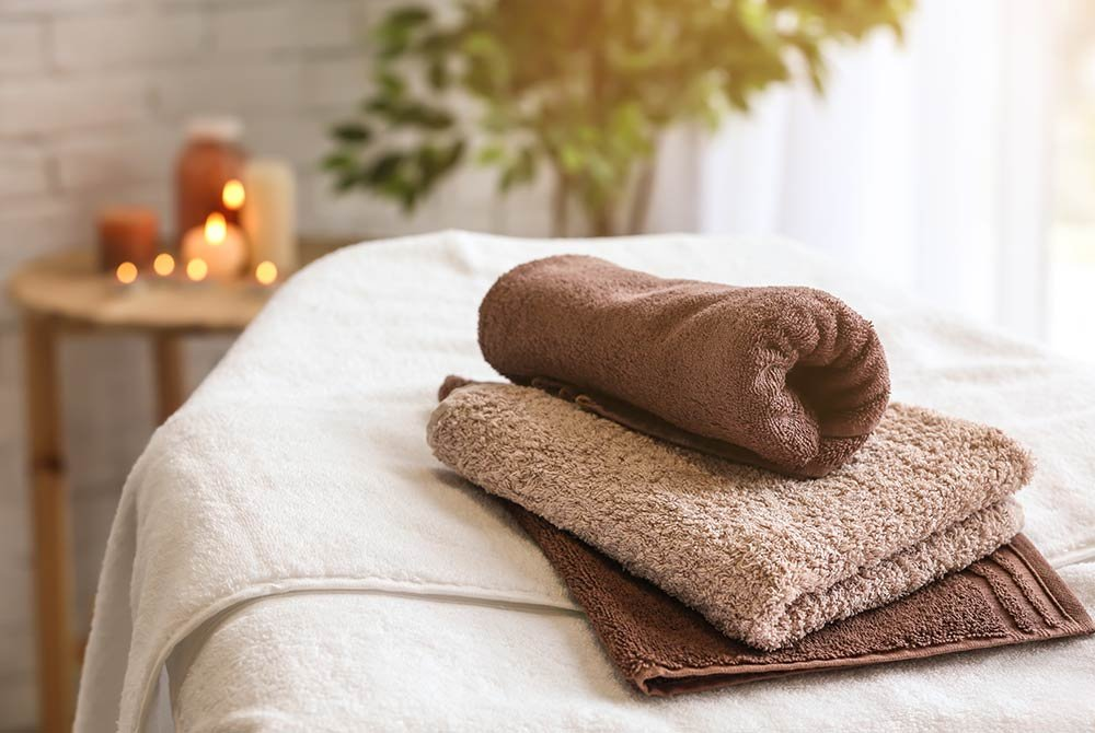 three towels on a massage table