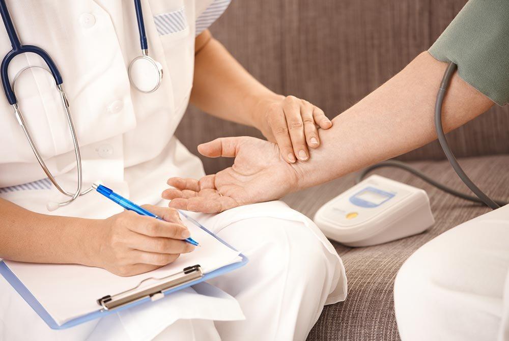 Healthcare Worker Taking Pulse of Patient