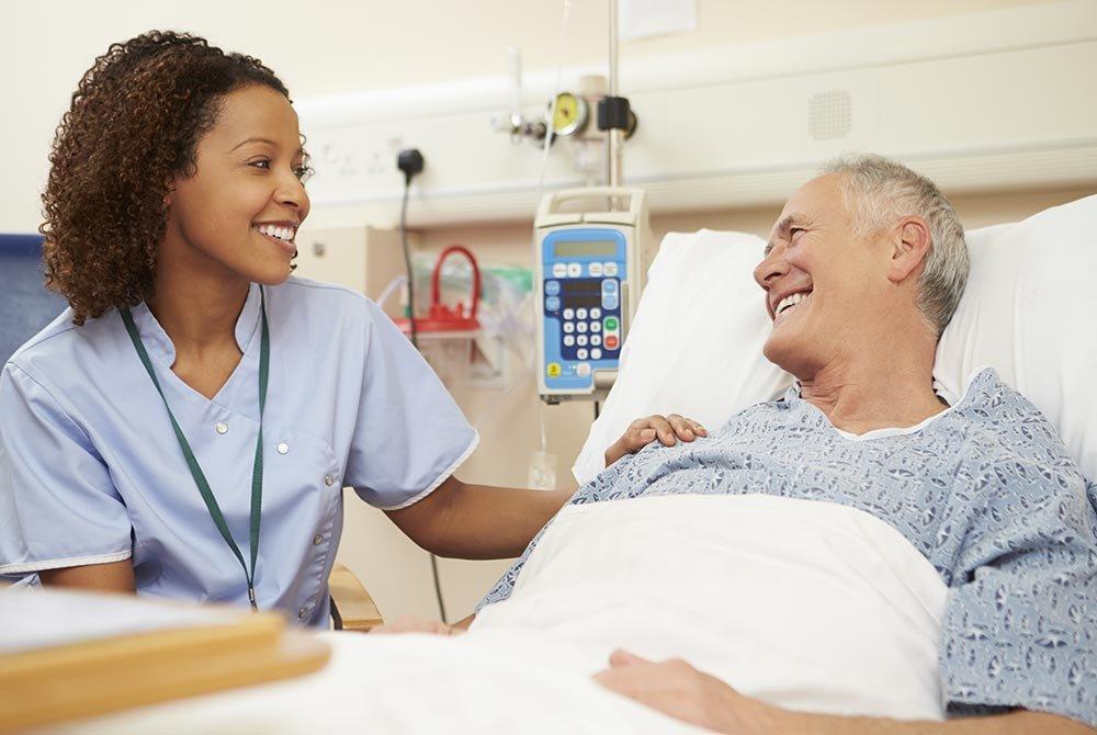 man in hospital with nurse