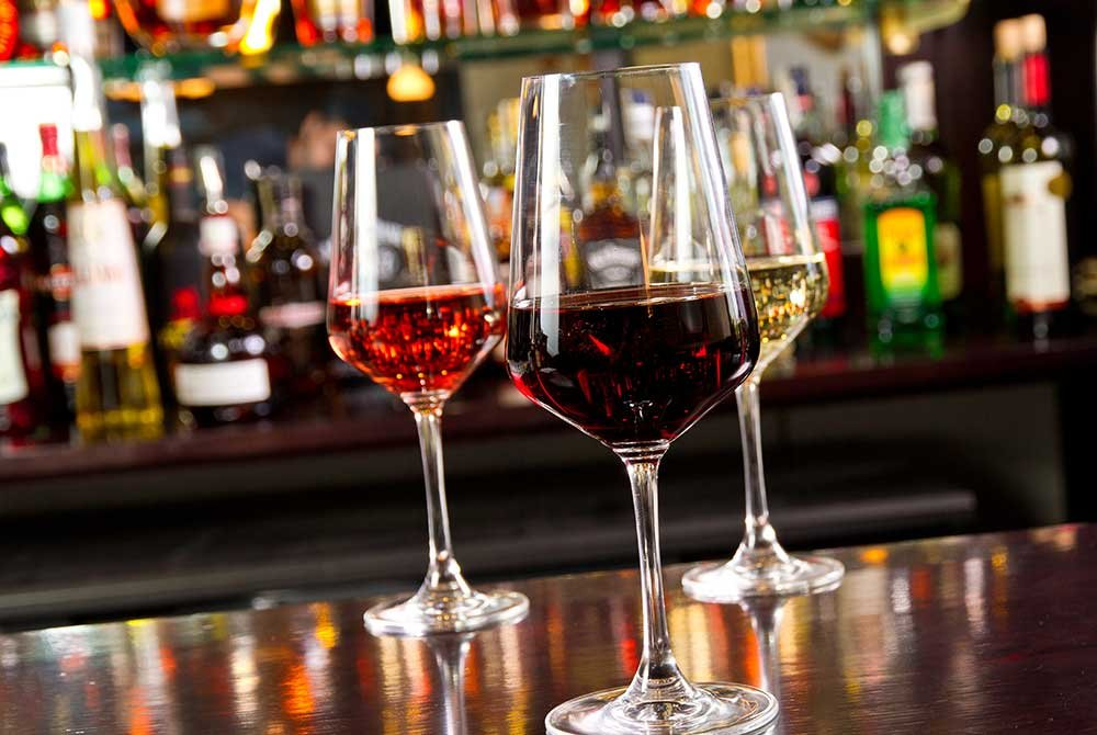 wine glasses on bar