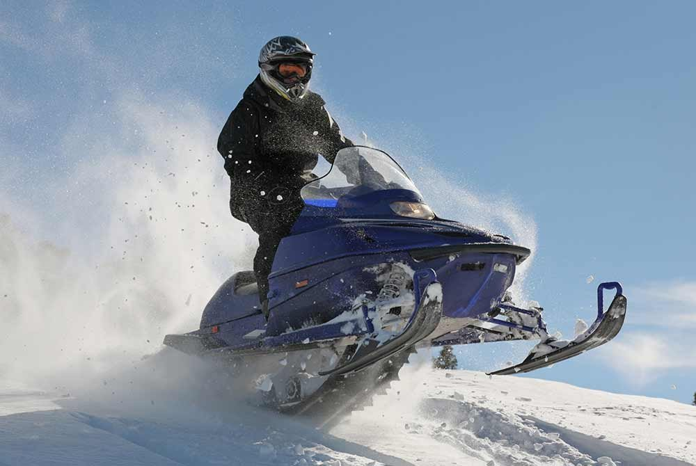 man on snowmobile