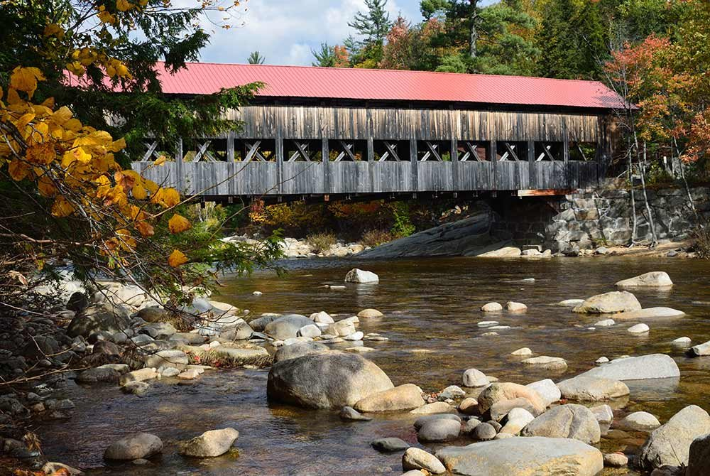 covered bridge over a river