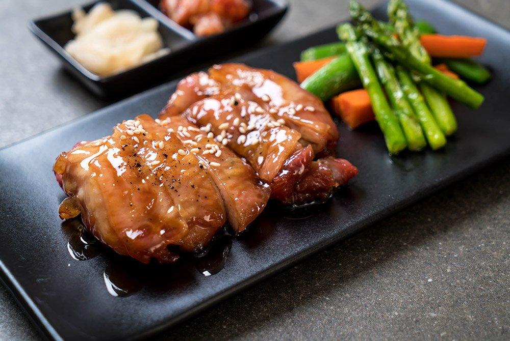 Japanese food and asparagus on a plate