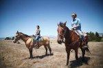 Two people horseback riding