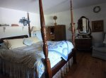 A carved four-poster bed