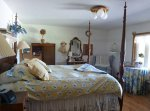 A bedroom with a blue and yellow theme
