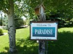 A sign that says Welcome to Paradise - Pete & Carol Reed