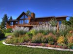 A large flowerbed in front of a large cabin