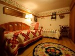 Two beds with geometric quilts