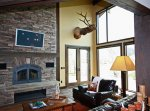 A sitting area decorated with a taxidermied elk