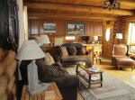 A sitting area in a log cabin