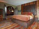 A bedroom with rustic wooden decor