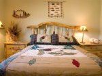 A bed with a rustic wooden frame