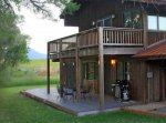 A cabin with a deck and wooden porch